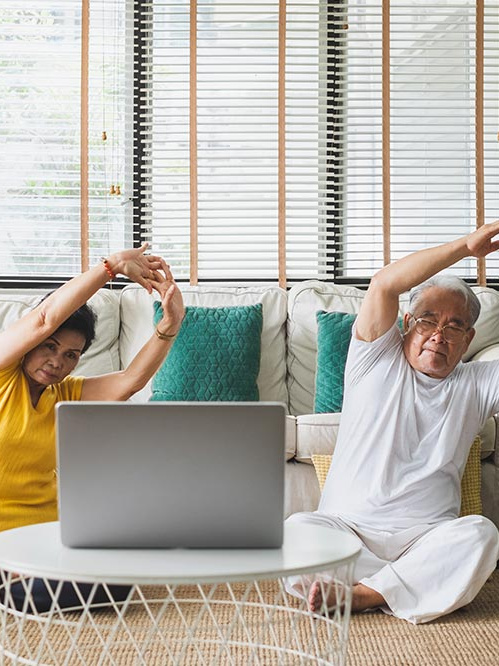 Elder Husband Wife Exercising - Senior Living Health Tips